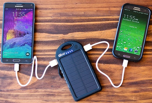 Smartphones Charging On Solar Charger
